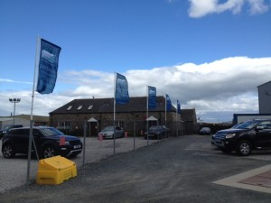 Flags at Jim Reid Vehicles Sales