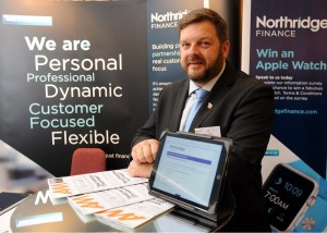 Mike Lomas at conference stand